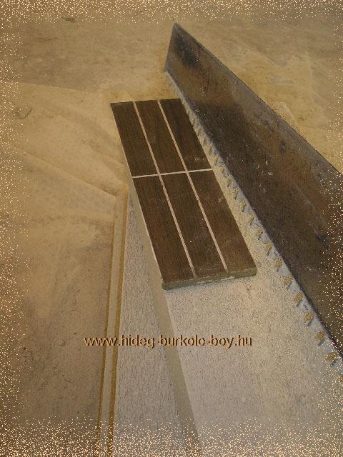 burkolat kiosztás kádelőfal építése során