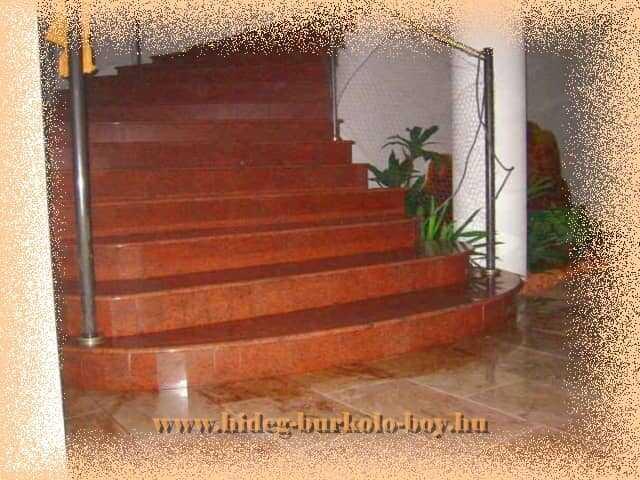 Íves lépcső gránit burkoló lapokkal