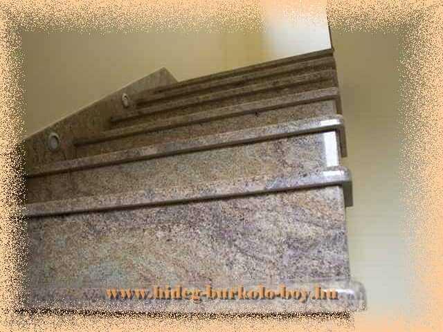 Lépcső gránit burkoló lapokkal, oldal világítással