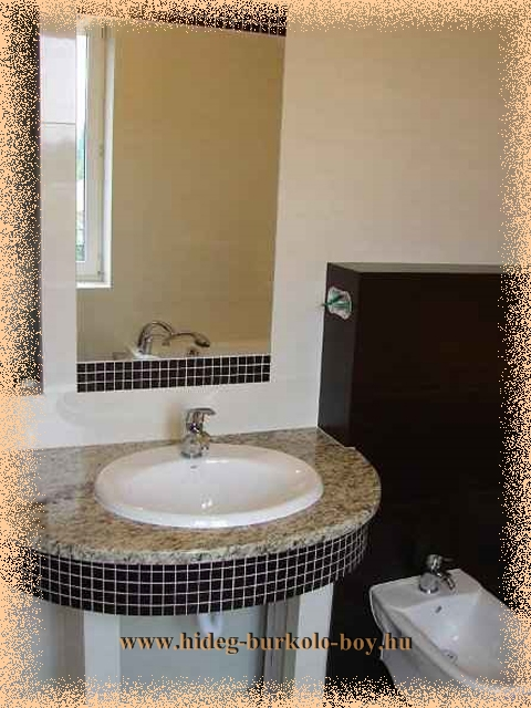 Lekerekített szélü gránit vagy márványlapból is készülhet a mosdó teteje